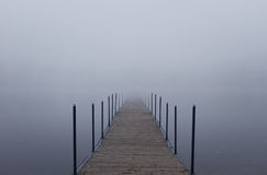 Endless jetty into a fog Stock Photography