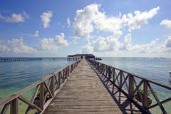 Endless jetty to the horizon; view to a turquoise sea and blue s Stock Photo