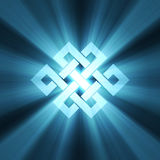Endless knot blue light flare Stock Photo