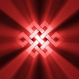 Endless knot symbol with light halo Stock Photo