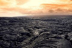 Endless lava fields of the Big Isalnd of Hawaii. Smooth, undulating surface of frozen pahoehoe lava. Hawaii, USA Royalty Free Stock Photos