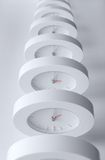 Endless line of equal clocks Royalty Free Stock Photography
