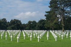 Long lines of white crosses at the American Cemetery and Memorial, Colleville-sur-Mer, Normandy, France. Endless lines of white crosses at the American Cemetery royalty free stock images