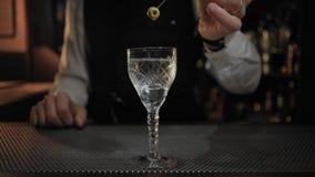 Endless loop cinemagraph of cocktail preparation stock footage