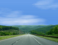 Endless Mountain View. Beautiful endless view of the mountains, so lucious green in spring like traveling down an endless road of nature's beauty Stock Images