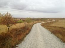 Endless path. Pilgrim`s journey. Camino de Santiago. Spain. The path through the fields. Autumn Royalty Free Stock Photo
