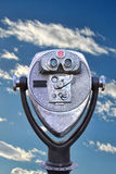 Endless Possibilities Viewer. Insert coins to view your hopes and dreams into this pay binocular overlooking blue skies and fluffy clouds Royalty Free Stock Photos