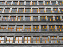 Endless repeated identical windows in a communist style building Royalty Free Stock Image