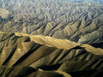 Endless Ridges, Afghanistan. The rugged ridges and peaks of Afghanistans mountains seem to go on forever stock images