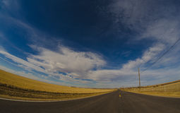 Endless Road. An long road heading into the horizon Stock Image
