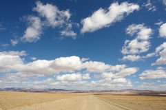 Endless Road. Endless gravel road into the desert stock images