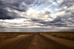 Endless road across the steppe Stock Photos