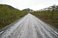 Endless road in arctic lapland Stock Photos