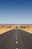 Endless Road (B1 in Namibia). Endless tar road into the desert stock photos