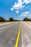 Endless road with blue sky. Endless road in Namibia, Caprivi Game Park, with blue sky Royalty Free Stock Images
