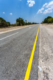 Endless road with blue sky. Endless road in Namibia, Caprivi Game Park, with blue sky Royalty Free Stock Photography