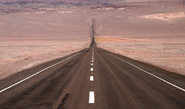 Endless road with geological feature Royalty Free Stock Photo