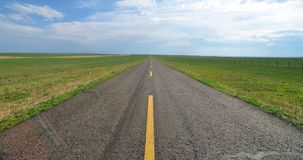 Endless road in the grassland Stock Photo
