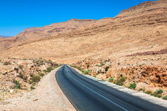 Endless road in Sahara Desert with blue sky,Morocco Africa.  Stock Images