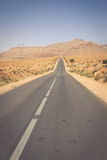 Endless road in Sahara Desert with blue sky,Morocco Africa Stock Images