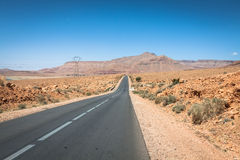 Endless road in Sahara Desert with blue sky,Morocco Africa Stock Photo