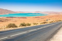 Endless road in Sahara Desert with blue sky,Morocco Africa.  Royalty Free Stock Images