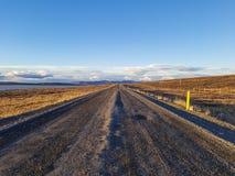 Endless road in volcanic desert Stock Photography