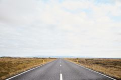 Endless roads in Iceland. The road to the horizon in Iceland. Typical Iceland landscape royalty free stock images