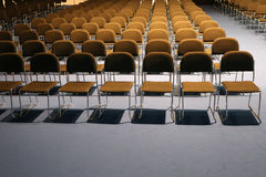 Endless rows of chairs in a modern conference hall Royalty Free Stock Images