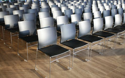 Endless rows of chairs in a modern conference hall Stock Photos
