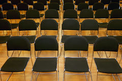 Endless rows of chairs in a modern conference hall Stock Photo
