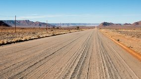 Endless sand road in Namibia stock photos
