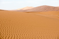 Endless sand waves on a sand dune of Namib Desert. Endless sand waves on a flat sand dune at Namib Desert stock photography