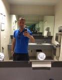 Endless selfie. Man taking selfie in the mirror in airport restroom, creating an effect of an endless selfie Royalty Free Stock Image