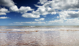 Endless skies over sidmouth beach. Calm seas in devon with endless summer skies Stock Images