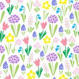 Endless spring blossom field pattern. Vector seamless colourful repeating pattern with early spring blooming flowers such as snowdrops, mascara, primrose Royalty Free Stock Images