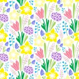 Endless spring blossom field pattern. Vector seamless colourful repeating pattern with early spring blooming flowers such as snowdrops, mascara, primrose Stock Photos