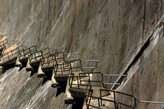 Endless stairs diagonally down a dam Stock Photos