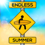 Endless summer yellow road sign on blurred beach Royalty Free Stock Images