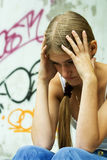 Endless troubles. The sad young girl regrets for the problems Stock Image