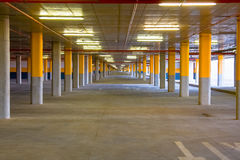 Endless underground parking facility. Underground parking facility for a shopping mall, showing plenty of empty space Royalty Free Stock Images