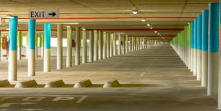Endless underground parking facility. Underground parking facility for a shopping mall, showing plenty of empty space Royalty Free Stock Image