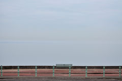 End of the road. Endless view at the end of the road. The sea view on the bench fades into the sky view. Pastel eternity at Portobello beach nearby Edinburgh Stock Photo