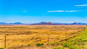 Endless wide open landscape of the semi desert Karoo Region in Free State and Eastern Cape. Provinces in South Africa under blue sky Royalty Free Stock Image