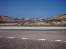 Endless wide tideland in the lagoon of Gorriones, Playa de Sotavento, Costa calma, Fuerteventura, Spain royalty free stock photography