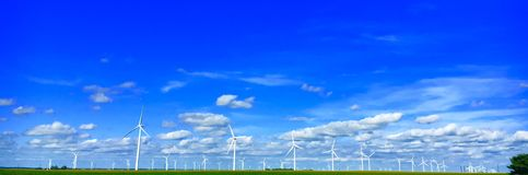 Endless Windmills. Windmills stretching on seemingly forever through cornfields Stock Photography