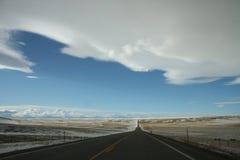Endlose Straße in Montana Lizenzfreie Stockbilder