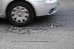 Endommagement des routes Photographie stock libre de droits