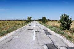 Endommagement des routes de la Serbie Photographie stock libre de droits