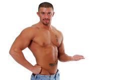 Endorsement. A very muscular bodybuilder holding out an empty hand, perfect for placing nutritional products stock photos